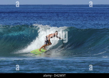 surfer riding wave Hawaii the Big Island pacific ocean surf surfing - Stock Photo