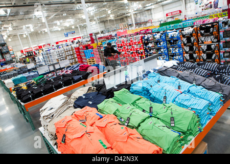 Customers shopping in the clothing section of a Costco Wholesale ...