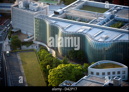 Daytime aerial view of metropolitan downtown Tokyo city skyline including the wavy glass facade of the National - Stock Photo