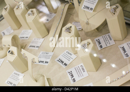 Diamond jewelry on display at a Costco Wholesale Warehouse Club. - Stock Photo