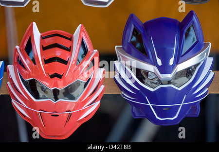 Children's plastic super hero masks in bright colors for sale at a festival stand in Japan. - Stock Photo