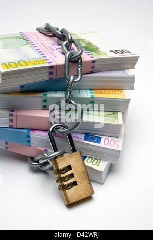 Freiburg, Germany, money stack with euro notes and a chain with a lock so - Stock Photo