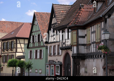Half-timbered houses in the village centre of Dambach-la-Ville, Alsace, France - Stock Photo