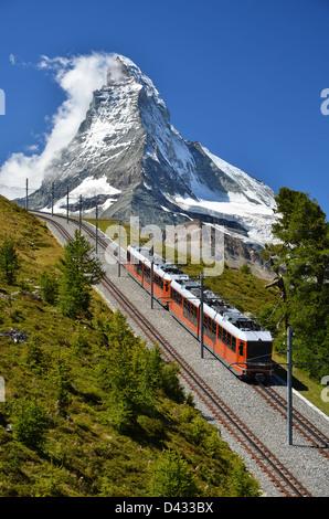 The Gornergratbahn is long gauge mountain rack railway. It leads from Zermatt (1604 m), up to the Gornergrat. - Stock Photo