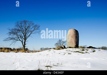 Ancient burial place marked with a famous runestone at Karlevi on the island Öland in the Baltic Sea. - Stock Photo
