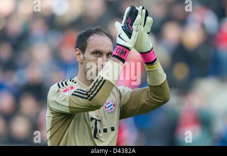 Munich's goalkeeper Tom Starke claps after the German Bundesliga soccer match between TSG 1899 Hoffenheim and FC - Stock Photo