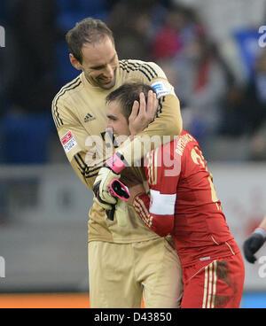 Munich's  goalkeeper Tom Starke (L) hugs  team mate Philipp Lahm after the German Bundesliga soccer match between - Stock Photo
