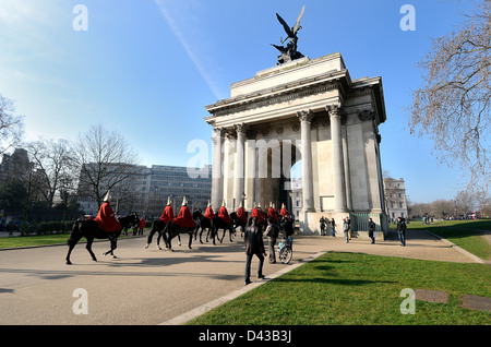 Wellington arch with Household cavalry passing through,London - Stock Photo