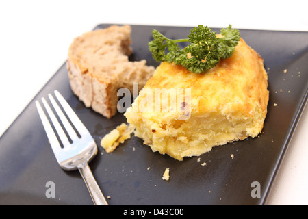 Spain Spanish Omelette made of potato and egg and onion served with parsley and bread Madrid Spain - Stock Photo