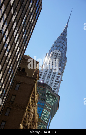 Top of the Chrysler building in morning light, as seen from below.  New York City. - Stock Photo
