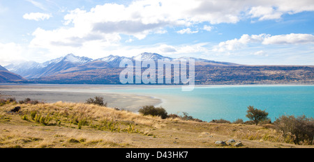 Beautiful panorama scenery Tasman turquoise lake in autumn Mt Cook national park southern Alps mountain valleys - Stock Photo