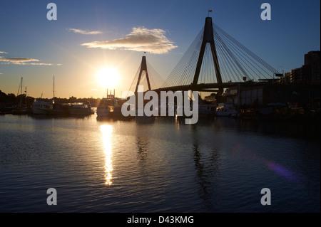 Glebe Island Bridge & Johnstons Bay, Pyrmont Sydney at sunset - Stock Photo