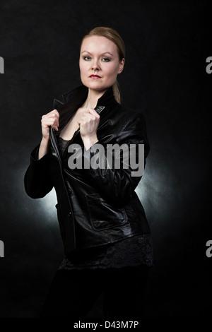 Beautiful blond danish caucasian woman in leather - Stock Photo