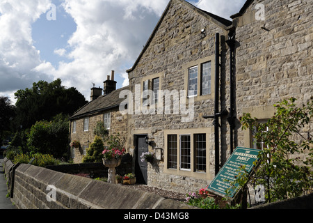 The Plague Cottages in the village of Eyam in Derbyshire Peak District England - Stock Photo