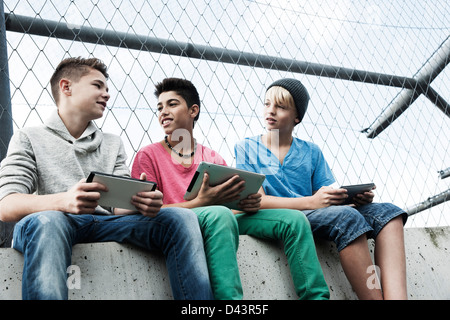 Boys with Tablets and Video Games in Playground, Mannheim, Baden-Wurttemberg, Germany - Stock Photo