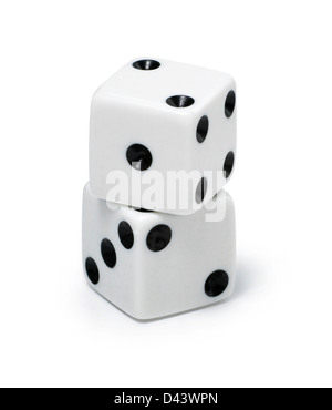 Two dice stacked on top of each over cut out white background - Stock Photo