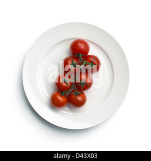 Cherry tomatoes cut out white background - Stock Photo