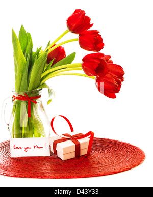 Image of beautiful red tulips bouquet in vase, white gift box with ribbon, greeting card, love you mom, happy mothers - Stock Photo