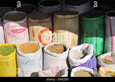 Sacks of colourful herbs and spices for sale in a market in Marrakesh, Morocco - Stock Photo