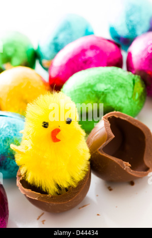 Chocolated Easter eggs wrapped in colorful foils. - Stock Photo