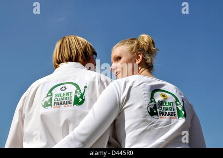 Participants of the Silent Climate Parade for Climate Protection and against Global Warming wear shirts with the - Stock Photo