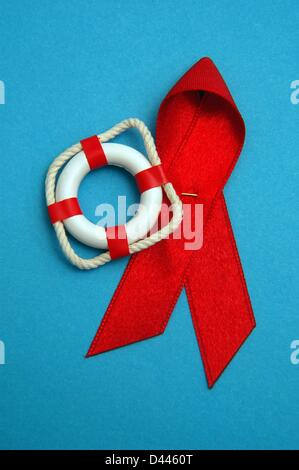 Illustration - A miniature safety buoy is pictured next to the red AIDS ribbon in Berlin, Germany, 10 December 2007. Photo: Berliner Verlag/S.Steinach