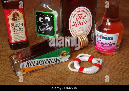 Illustration -  A miniature safety buoy is pictured next to various small liqueur bottles in Berlin, Germany, 22 December 2007. Photo: Berliner Verlag/S.Steinach