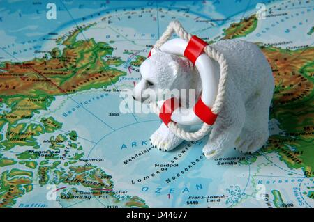 Illustration - A miniature polar bear is pictured with a miniature safety buoy around his neck sitting near the north pole on a map in Berlin, Germany, 22 December 2007. Photo: Berliner Verlag/S.Steinach
