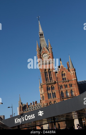 Clock tower of St Pancras International railway station with the entrance to Kings Cross railway station in the - Stock Photo