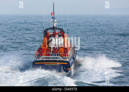 Moelfre, Isle of Anglesey, Wales, UK, Mon 4th March 2013. RNLI lifeboat crew arrive in the new £2.7 million Tamar - Stock Photo