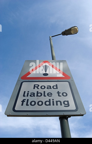 british road liable to flooding road sign with exclamation mark above - Stock Photo