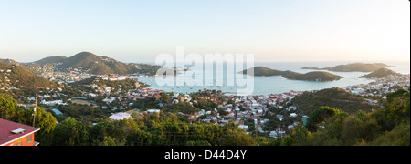 Sunset over the harbor of Charlotte Amalie in St Thomas with view over town and yachts in bay - Stock Photo