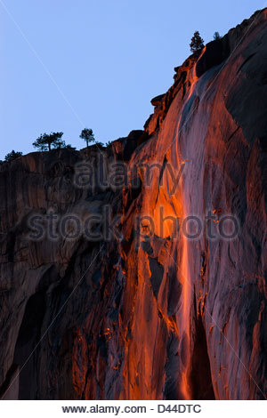 Horsetail Fall, an ephemeral waterfall, plunges from the top of El Capitan in Yosemite National Park, California. - Stock Photo