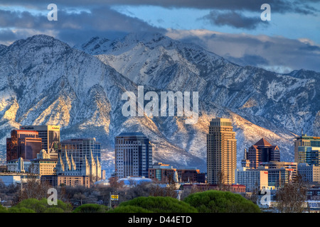 Panoramic view of the downtown Salt Lake City skyline in early spring with the snow capped Wasatch Mountains in - Stock Photo