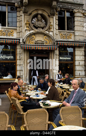 People at outdoor cafe on the Grand Place square in Brussels, Belgium - Stock Photo