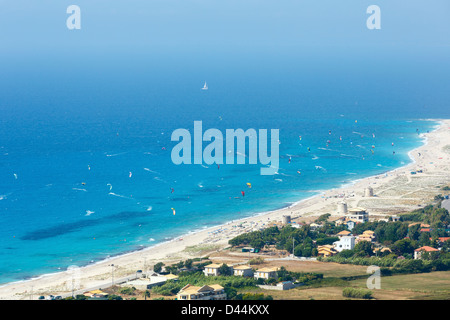 Beautiful summer Lefkada coast beach and kiteboarders (Greece, Ionian Sea, view from up). All people are not identifiable. - Stock Photo