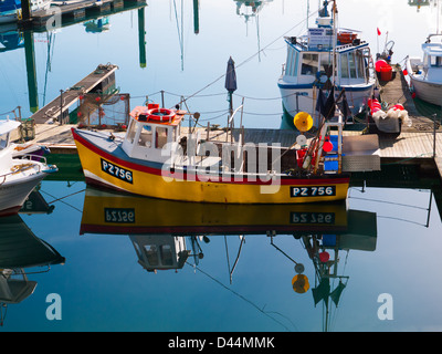 Brightly painted fishing boat moored in Torquay harbour, Devon, UK. - Stock Photo