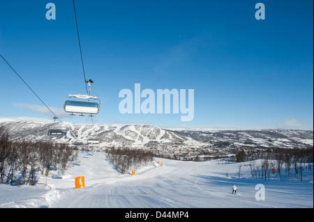Easy runs dominate the slopes in the Geilolia skiing area around Kikut mountain in Geilo, Norway - Stock Photo
