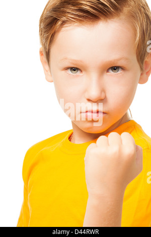 Bad tempered kid showing his fist ready to punch isolated on white - Stock Photo