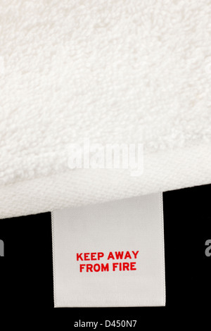 Keep away from fire label on a white towel - Stock Photo