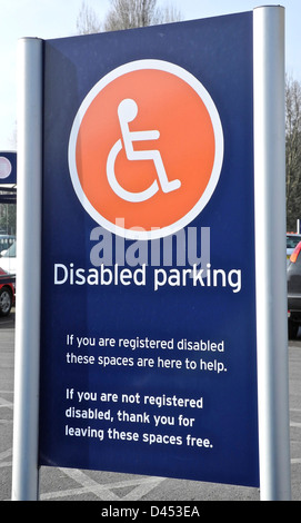 Disabled Parking sign in supermarket - Stock Photo