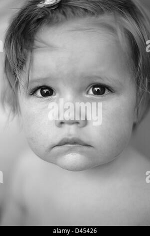 Portrait of unhappy toddler, black and white - Stock Photo