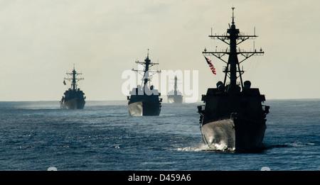 The Arleigh Burke-class guided-missile destroyers USS Kidd, USS Dewey, USS Pinckney, USS Wayne E. Meyer and the - Stock Photo
