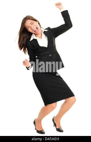Ecstatic and excited beautiful multiracial young business woman dancing and celebrating success isolated on white - Stock Photo