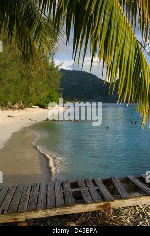 Ramshackle jetty on the beach near Fare, Huahine, French Polynesia - Stock Photo