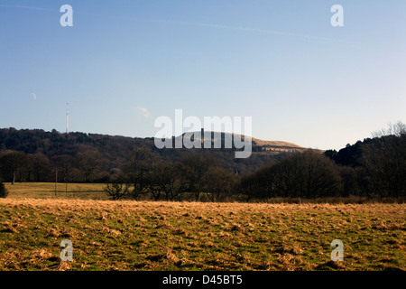 Television masts on top of Winter Hill in winter and Rivinington Pike  Rivington near Horwich Bolton Lancashire - Stock Photo