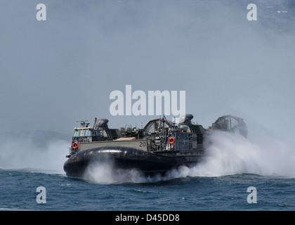 A landing craft air cushion prepares to enter the welldeck. - Stock Photo