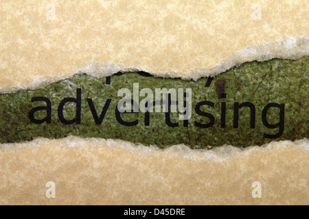 Advertising text on paper hole - Stock Photo