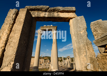 Stone door frame to the corner columns of the Agora Greek Gate Hellenistic tower at the Perge ruins Turkey - Stock Photo