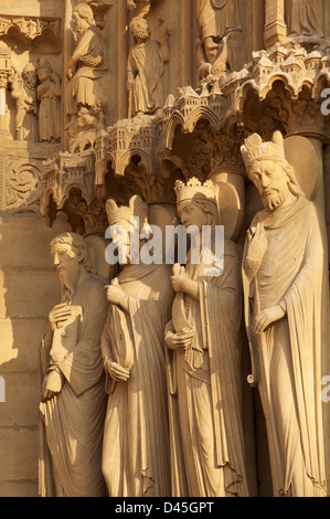 French Gothic. Statues on the West Front of Notre Dame Cathedral. They represent Saint Paul, King David, Bathsheba - Stock Photo